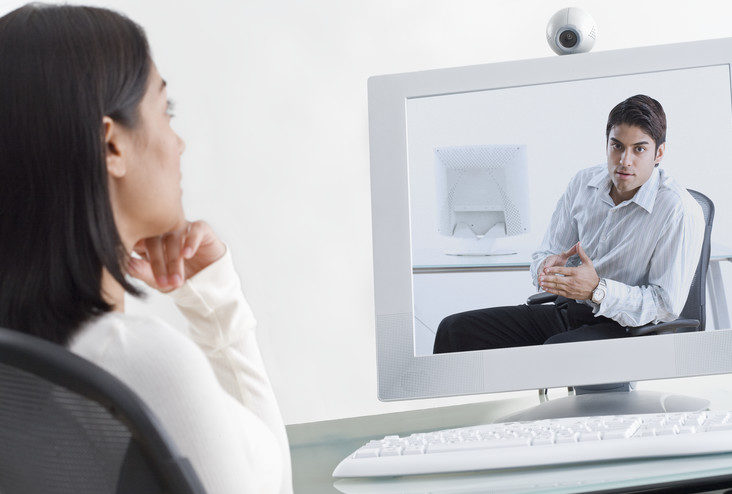 Businesswoman on Videoconference with Businessman